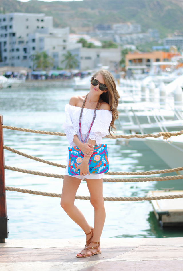 Summer outfit with bright, fun embroidered clutch