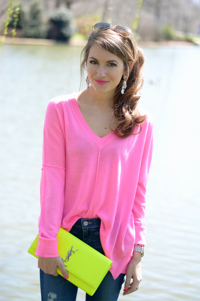 Neon pink sweater and YSL clutch