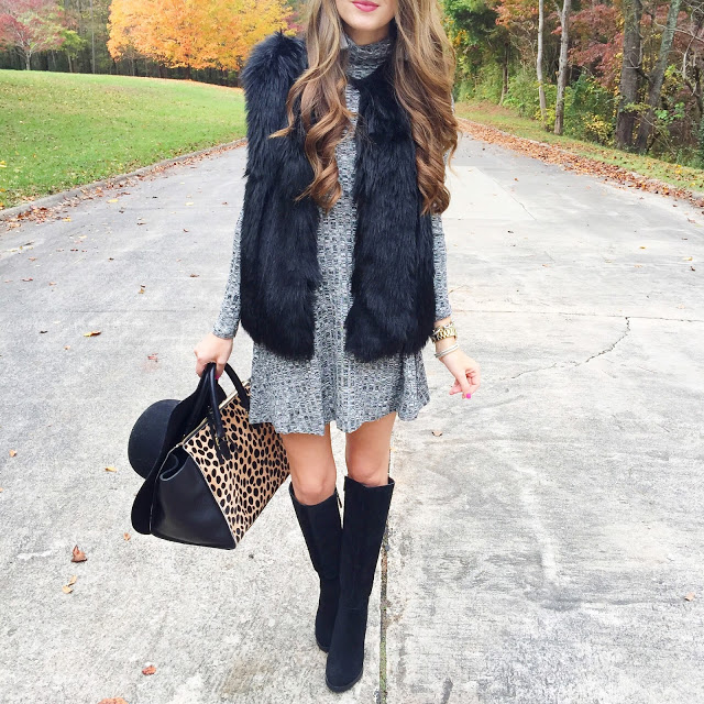 Sweater dress paired with faux fur vest