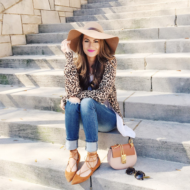 floppy hat and leopard cardigan